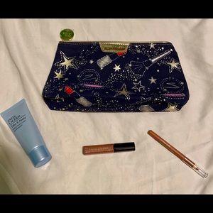 Estée Lauder bag with lotion, lip pencil, & gloss